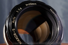 Front element of the 55mm f/1.2. In spite of it's very wide front element, it still uses the common 52mm filter thread.
